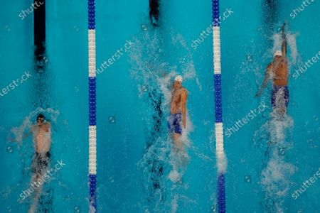 Shaine Casas, Ryan Murphy and Hunter Armstrong participate in the men's 100 backstroke during wave 2 of the U.S. Olympic Swim Trials, in Omaha, Neb