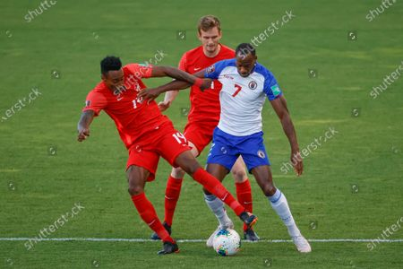 Canada's Mark-Anthony Kaye (14) competes for the ball with Haiti's Herve Bazile (7) during the first half of a World Cup qualifying soccer match, in Bridgeview, Ill