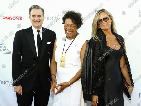 Stock Picture of Chairman and CEO of Macy's, Inc. Jeff Gennette, from left, artist Carrie Mae Weems and honoree Angela Ahrendts attend the 72nd annual Parsons Benefit presented by The New School at The Rooftop at Pier 17, in New York