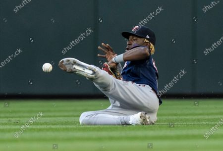 Minnesota Twins center fielder Nick Gordon is unable to get to a ball before it drops in for a hit by Seattle Mariners' Jake Bauers during the third inning of a baseball game, in Seattle. The Mariners won 10-0
