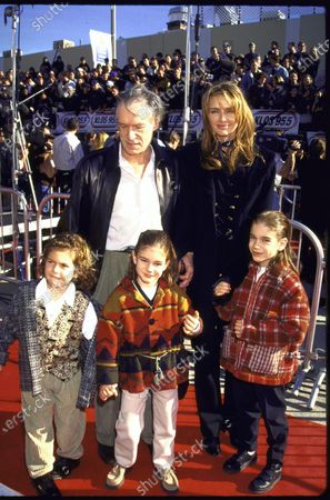 PLAYBOY magazine publisher Hugh Hefner and wife, model Kimberley Conrad, w. their children at film premiere of Star Wars: Special Edition.