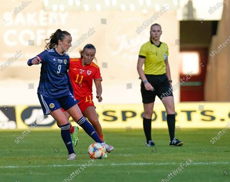 Stock Image of Caroline Wier (L) and Natasha Harding are seen in action during the Women's Friendly football match between Wales and Scotland at Parc Y Scarlets.(Final score; Wales 0:1Scotland).