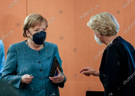 German Chancellor Angela Merkel (L) talks with German Federal Government Commissioner for Culture and the Media Monika Gruetters before the weekly meeting of the German Federal cabinet in the conference hall of the Chancellery in Berlin, Germany, 16 June 2021.