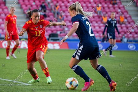 Natasha Harding (11 Wales) puts pressure on Kirsty Smith (2 Scotland) during the International Friendly game between Wales and Scotland at Parc y Scarlets in Llanelli, Wales.