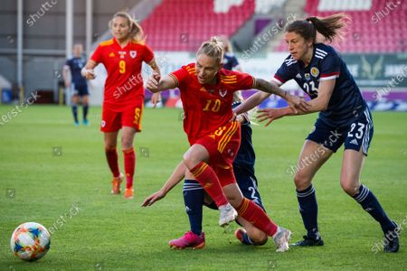 Jessica Fishlock (10 Wales) is tackled by Kirsty Smith (2 Scotland) and Lizzie Arnot (23 Scotland) during the International Friendly game between Wales and Scotland at Parc y Scarlets in Llanelli, Wales.