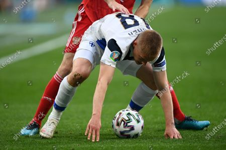 Robin Lod (front) of Finland in action against Mario Fernandes of Russia during the UEFA EURO 2020 group B preliminary round soccer match between Finland and Russia in St.Petersburg, Russia, 16 June 2021.