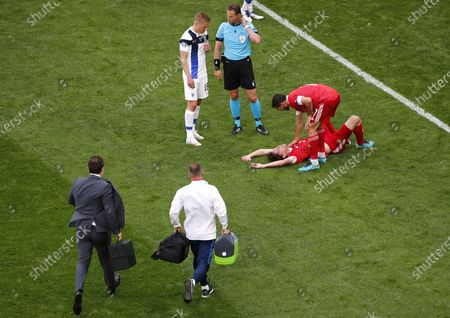Mario Fernandes (bottom R) of Russia reacts after being injured during the UEFA EURO 2020 group B preliminary round soccer match between Finland and Russia in St.Petersburg, Russia, 16 June 2021.