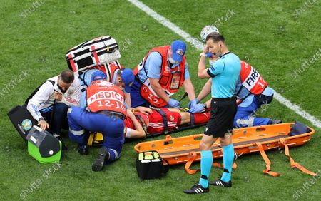 Mario Fernandes (bottom C) of Russia is stretchered off the pitch after being injured during the UEFA EURO 2020 group B preliminary round soccer match between Finland and Russia in St.Petersburg, Russia, 16 June 2021.