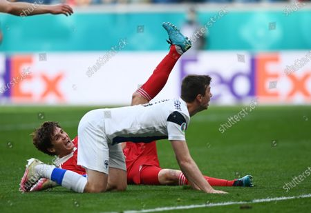 Mario Fernandes (L) of Russia reacts after a tackle from Daniel O'Shaughnessy of Finland  during the UEFA EURO 2020 group B preliminary round soccer match between Finland and Russia in St.Petersburg, Russia, 16 June 2021.