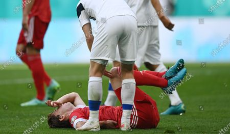 Mario Fernandes (down) of Russia reacts after a tackle during the UEFA EURO 2020 group B preliminary round soccer match between Finland and Russia in St.Petersburg, Russia, 16 June 2021.