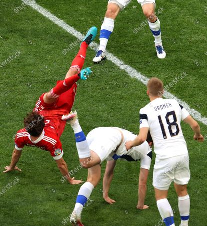 Mario Fernandes (L) of Russia in action during the UEFA EURO 2020 group B preliminary round soccer match between Finland and Russia in St.Petersburg, Russia, 16 June 2021.