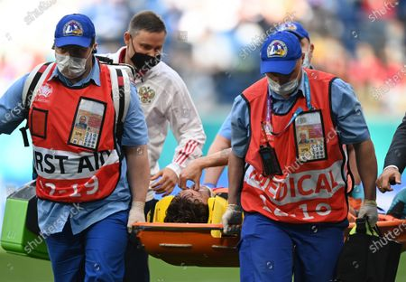 Mario Fernandes of Russia is stretchered off the pitch during the UEFA EURO 2020 group B preliminary round soccer match between Finland and Russia in St.Petersburg, Russia, 16 June 2021.