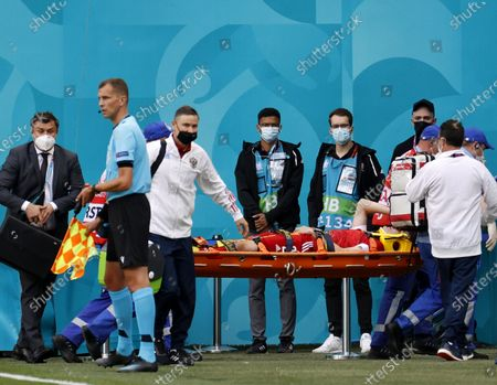 Mario Fernandes of Russia is stretchered off the pitch after being injured during the UEFA EURO 2020 group B preliminary round soccer match between Finland and Russia in St.Petersburg, Russia, 16 June 2021.