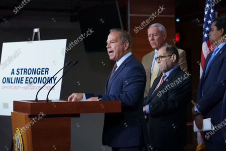 From left, Rep. David Cicilline, D-R.I., chairman of the House Judiciary antitrust subcommittee, Rep. Ken Buck, R-Colo., the ranking member of the antitrust subcommittee, House Judiciary Committee Chair Jerrold Nadler, D-N.Y., and Rep. Joe Neguse, D-Colo., speaks to reporters about antitrust bills to be introduced at the Capitol in Washington