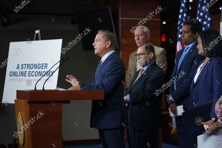 From left, Rep. David Cicilline, D-R.I., chairman of the House Judiciary antitrust subcommittee, Rep. Ken Buck, R-Colo., the ranking member of the antitrust subcommittee, House Judiciary Committee Chair Jerrold Nadler, D-N.Y., Rep. Joe Neguse, D-Colo., and Rep. Pramila Jayapal, D-Wash., chair of the Congressional Progressive Caucus, speaks to reporters about antitrust bills to be introduced at the Capitol in Washington