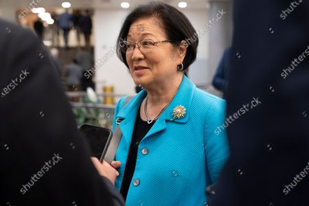 Sen. Mazie Hirono, D-Hawaii, speaks with reporters while arriving for a Senate vote, on Capitol Hill in Washington