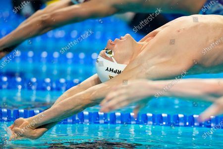 Ryan Murphy dives at the start of the men's 100-meter backstroke final during wave 2 of the U.S. Olympic Swim Trials, in Omaha, Neb