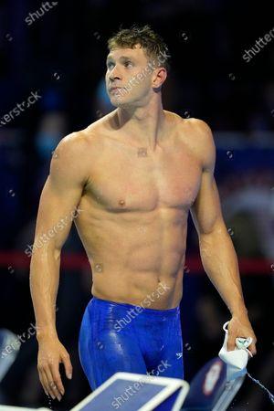 Ryan Murphy walks on the pool deck winning the men's 100-meter backstroke final during wave 2 of the U.S. Olympic Swim Trials, in Omaha, Neb