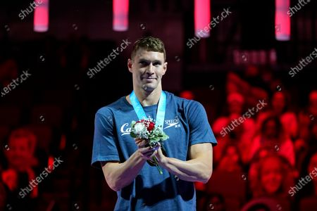Stock Picture of Ryan Murphy reacts during the medal ceremony after winning the men's 100-meter backstroke final during wave 2 of the U.S. Olympic Swim Trials, in Omaha, Neb