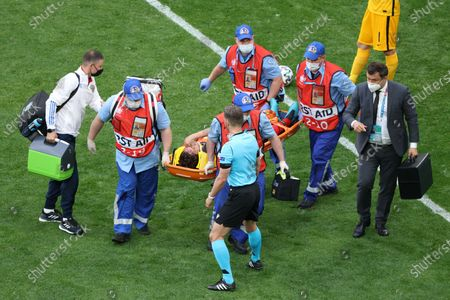 Mario Fernandes (2) of Russia lying on a stretcher during the European championship EURO 2020 between Russia and Finland at Gazprom Arena. (Final Score; Finland 0:1 Russia).