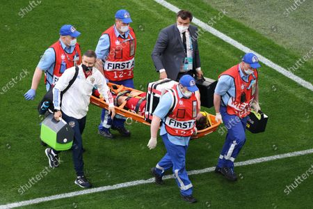 Mario Fernandes (2) of Russia lying on stretcher during the European championship EURO 2020 between Russia and Finland at Gazprom Arena. (Final Score; Finland 0:1 Russia).