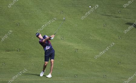 Stock Photo of Martin Laird of Scotland hits from the fairway on the thirteenth hole during the final practice round for the 2021 US Open golf tournament on the South Course of the Torrey Pines Golf Course in San Diego, California, USA, 16 June 2021.