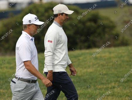 Adam Scott (R) and Matt Jones (L) of Australia walk up the fairway on the fourteenth hole during the final practice round for the 2021 US Open golf tournament on the South Course of the Torrey Pines Golf Course in San Diego, California, USA, 16 June 2021.