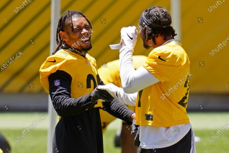 Pittsburgh Steelers cornerback Joe Haden, left, and defensive back Marcus Allen, right, share a laugh during the team's NFL mini-camp football practice in Pittsburgh