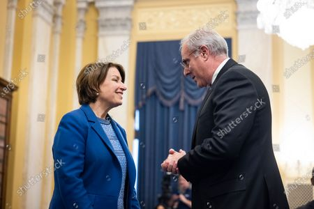 Michael Bolton (R), Inspector General of the US Capitol Police, speaks with Democratic Senator from Minnesota Amy Klobuchar (L) prior to testifying before a Senate Rules and Administration oversight committee hearing on the Capitol Police in the wake of the 06 January attack on the US Capitol in the Russell Senate Office Building in Washington, DC, USA, 16 June 2021.