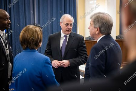 Stock Image of Michael Bolton (C), Inspector General of the US Capitol Police, prepares to testify before a Senate Rules and Administration oversight committee hearing on the Capitol Police in the wake of the 06 January attack on the US Capitol in the Russell Senate Office Building in Washington, DC, USA, 16 June 2021.