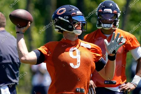 Chicago Bears quarterback Nick Foles throws a ball during NFL football practice in Lake Forest, Ill