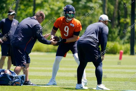 Chicago Bears quarterback Nick Foles works on the field during NFL football practice in Lake Forest, Ill