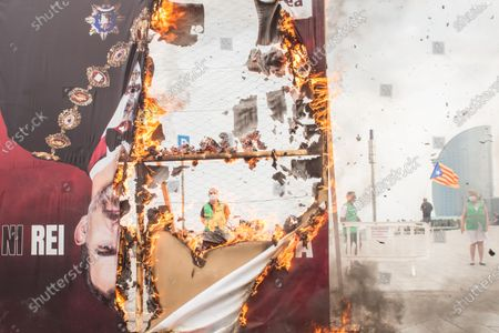 An upside down photo of Spanish king, Felipe VI is seen in flames, during the demonstration. The Catalan association that aims at achieving the political independence of Catalonia, the Catalan National Assembly (ANC), has called a demonstration on Barceloneta close to Hotel W Barcelona where the Spanish king, Felipe VI attends the inaugural dinner of the Annual Meeting of the Barcelona business organization, Circulo de Economia (Economy Circle), to protest the presence of the monarch in the Catalan capital. The protesters have burned a large photo of Felipe VI and have had the presence of the vice president of the ANC, David Fernández.