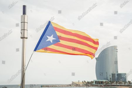 A Catalan independence flag waving, during the demonstration. The Catalan association that aims at achieving the political independence of Catalonia, the Catalan National Assembly (ANC), has called a demonstration on Barceloneta close to Hotel W Barcelona where the Spanish king, Felipe VI attends the inaugural dinner of the Annual Meeting of the Barcelona business organization, Circulo de Economia (Economy Circle), to protest the presence of the monarch in the Catalan capital. The protesters have burned a large photo of Felipe VI and have had the presence of the vice president of the ANC, David Fernández.