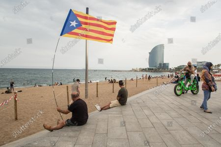 A protester waving a Catalan independence flag, during the demonstration. The Catalan association that aims at achieving the political independence of Catalonia, the Catalan National Assembly (ANC), has called a demonstration on Barceloneta close to Hotel W Barcelona where the Spanish king, Felipe VI attends the inaugural dinner of the Annual Meeting of the Barcelona business organization, Circulo de Economia (Economy Circle), to protest the presence of the monarch in the Catalan capital. The protesters have burned a large photo of Felipe VI and have had the presence of the vice president of the ANC, David Fernández.
