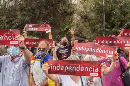 Protesters with placards that say, Independence, during the demonstration. The Catalan association that aims at achieving the political independence of Catalonia, the Catalan National Assembly (ANC), has called a demonstration on Barceloneta close to Hotel W Barcelona where the Spanish king, Felipe VI attends the inaugural dinner of the Annual Meeting of the Barcelona business organization, Circulo de Economia (Economy Circle), to protest the presence of the monarch in the Catalan capital. The protesters have burned a large photo of Felipe VI and have had the presence of the vice president of the ANC, David Fernández.