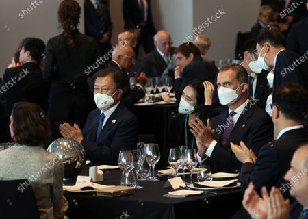 South Korean President Moon Jae-in (L) claps with Spanish King Felipe VI (R) while attending the opening dinner of Spain's annual economic forum in Barcelona, Spain, 16 June 2021. Moon is on a three-day state visit that began the previous day.