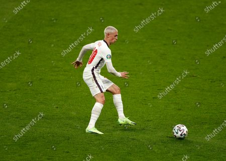 Stock Image of Phil Foden of England on the ball while styling the bleached hair inspired by Euro 96 England legend Paul Gascoigne; Wembley Stadium, London, England; 2021 European Football Championships, England versus Scotland.