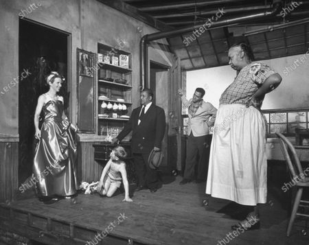 Ethel Waters (R), Brandon DeWilde (2L), and others looking in confusion at Julie Harris's (L) outlandish dress in scene from The Member of the Wedding.