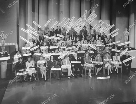 Many famous actors and actresses at MGM (Metro Goldwyn Mayer) Studio, having an anniversary portrait taken together with studio chief Louis B. Mayer.