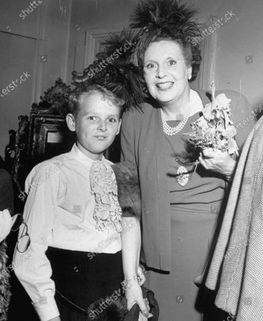 UNITED KINGDOM - JULY 01:  At the wedding of Raine McCorquodale to Gerald Legge, the bride's mother, novelist Barbara Cartland (R) standing with her son Ian Mccorquodale (L).