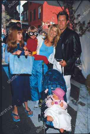 Model Christie Brinkley (2R) with husband Peter Cook (R) and children Jack (C) , Alexa Ray (L) & Sailor (in stroller) at the 6th annual Kids For Kids celebrity street fair and carnival held by the Elizabeth Glaser Pediatric AIDS Foundation.