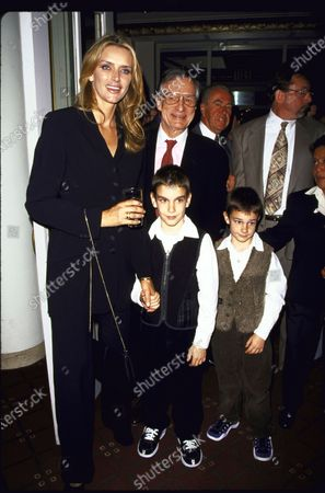 Hugh Hefner with wife Kimberly and their sons Marston and Cooper.