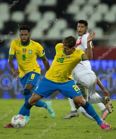 Roberto Firmino supported by Fred of Brazil; Nilton Santos Stadium, Rio de Janeiro, Brazil; Copa America, Brazil versus Peru.