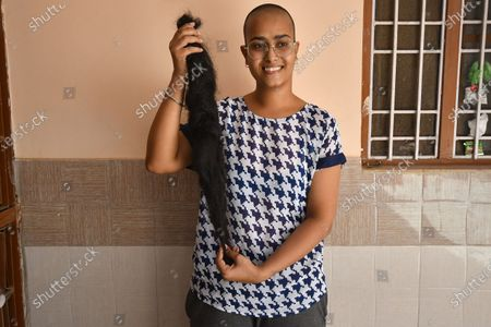 Varsha Kumawat after shaving her head to donate hair for cancer patients in Ajmer in the Indian state of Rajasthan.