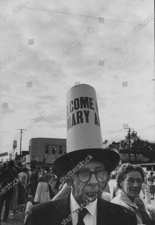 A member of the crowd welcoming Miss America 1958, Mary Ann Mobley.