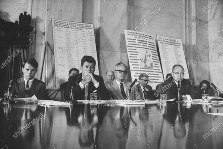 (L-R) Sen. Robert F. Kennedy, Sen. John F. Kennedy, Sen. Barry Goldwater, and Sen. Carl T. Curtis attending a labor hearing.