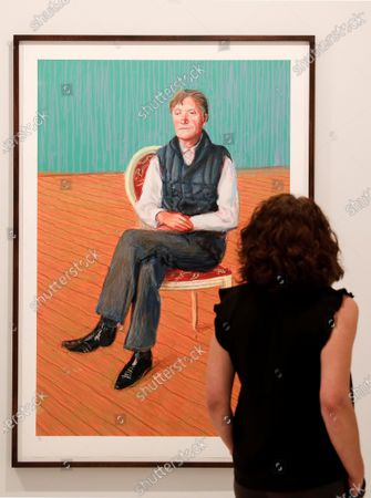 A visitor looks at the artwork 'Sir Tatton Sykes' (2008) by David Hockney during the exhibition 'London Calling. British Art Today' at Bancaja Foundation in Valencia, Spain, 17 June 2021. The display features works by artists such David Hockney, Sean Scully, Julian Opie, Damien Hirst and Idris Khan, among others, and will run until 17 October 2021.