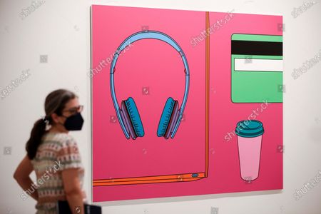 Stock Picture of A visitor looks at the artwork 'Commonplane (with headphones)' (2017), by Michael Craig-Martin, during the exhibition 'London Calling. British Art Today' at Bancaja Foundation in Valencia, Spain, 17 June 2021. The display features works by artists such David Hockney, Sean Scully, Julian Opie, Damien Hirst and Idris Khan, among others, and will run until 17 October 2021.