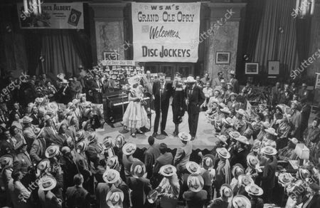 (L-R) Radio Singer & Comedian, Minnie Pearl entertaining with Gov. Frank G. Clement and his wife and Mitch Miller at the Grand Ole Opry.